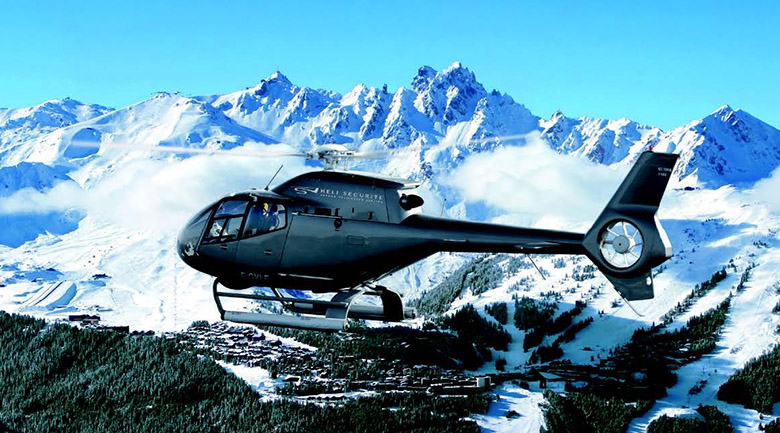 EC-120 Helicopter flying over Courchevel
